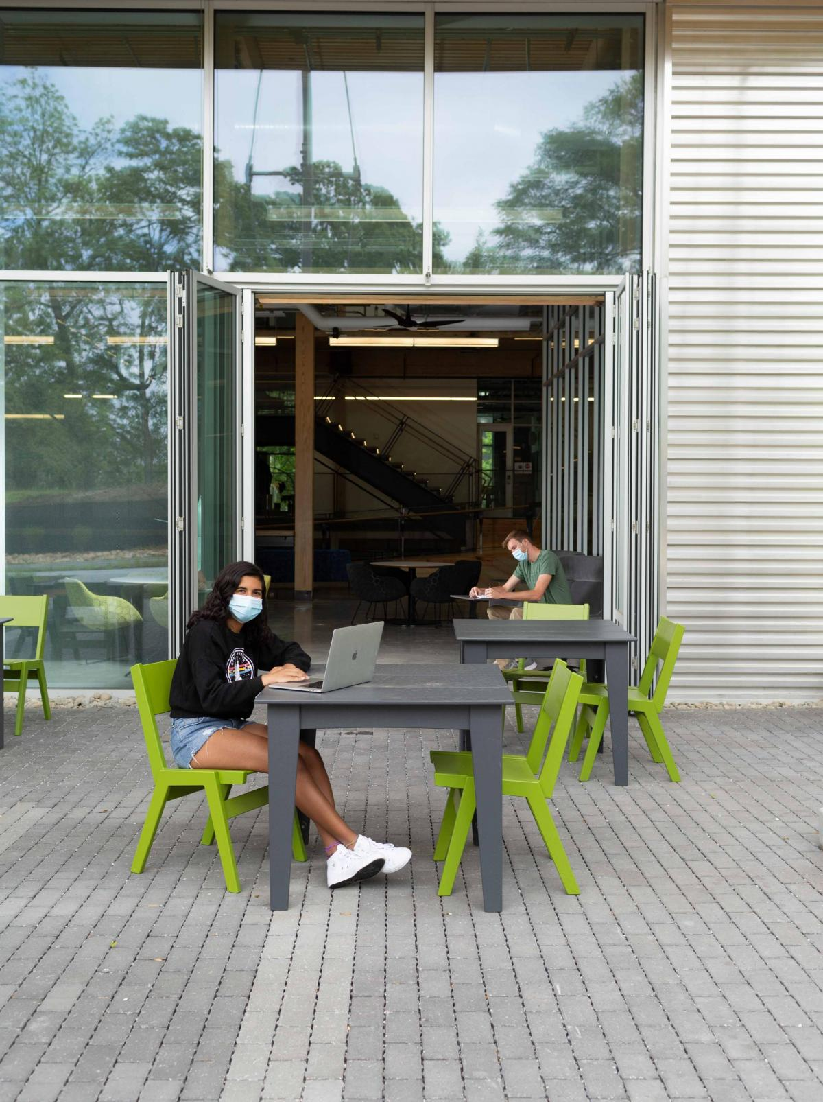 Students socially distant at outside seating