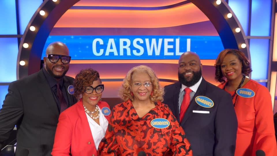 Carswell Family Pose on television set